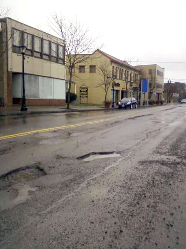 Potholes abound on Third Street, on what was once hoped to be a tourist magnet.