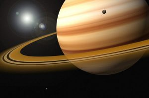 Saturn is surrounded by a disk of rocks and ice fragments orbits the planet's equatorial plane.