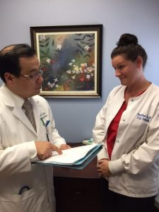 Dr. Won Sam Yi with Heather Slocum               ...CCS Oncology CEO says cancer care provider being dropped by Independent Health.