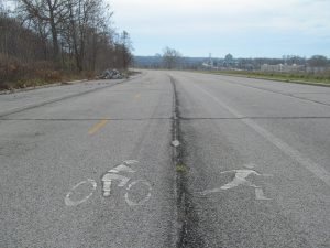 Ancient pictoglyphs on the closed lanes of the Niagara Scenic Parkway reveal that prehistoric cultures liked to run each other down with bicycles.
