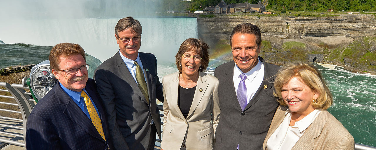 Mayor Dyster chums it up with his pals in the Niagara Falls State Park. L to R, State Parks Western Region director Mark Thomas of Chautauqua County, Dyster, State Parks Commissioner Rose Harvey, Cuomo, unknown.