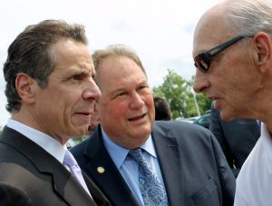 Gov. Cuomo and ex-Assemblyman Ceretto get an earful from a constituent.