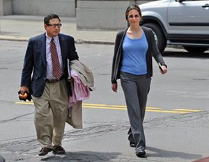 Clare Bronfman with her attorney William Savino. Savino drew up her verified complaint where she swore under oath that she had no written agreement with Parlato, which contradicts entirely the government's allegation that there was a written agreement.
