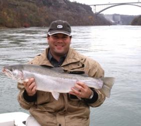 Angler holding Lower Niagara River steelhead