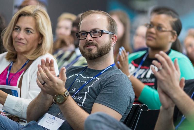 """Tom Lowe, dressed to impress in one of his nicest t-shirts, represents Niagara University and the city of Niagara Falls at UB's Center for Leadership and Organizational Effectiveness inaugural """"Social Innovation"""" conference this past April."""
